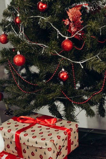 Christmas Holiday Celebration Decoration christmas tree Tree Christmas Decoration Red Christmas Ornament Indoors  Holiday - Event Close-up No People Celebration Event Gift Plant Christmas Lights Hanging