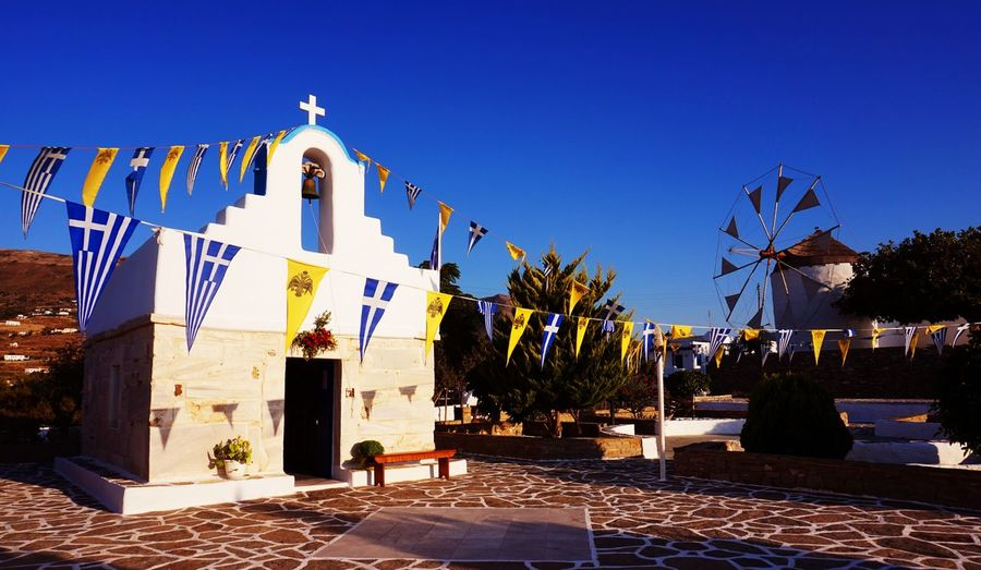 Cyclades Islands Greek Life White Church Clear Sky Discovering The Island Flags Waving Honeymoon Husband And Wife Roadtrip Travel Destinations Water Mill White And Blue