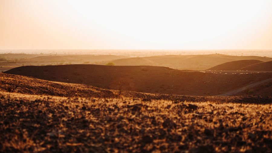 Landscape Environment Scenics - Nature Tranquil Scene Tranquility Sky Beauty In Nature Mountain Nature Land No People Non-urban Scene Idyllic Remote Day Desert Outdoors Sunlight Horizon Clear Sky Arid Climate Climate Rolling Landscape