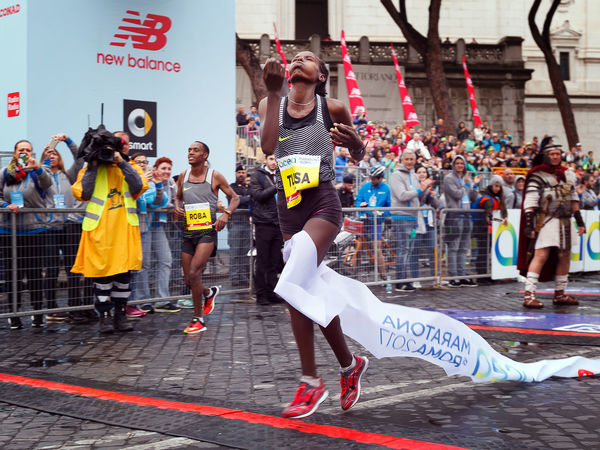 Rome, Italy - April 2, 2017: Rahma Tusa Chota is the winner of the women's race the 23rd Rome Marathon, with a time of 2:27:21. Tusa on his arrival at the finish line. Adult Adults Only Athlete Day Etiopian Finish Line  Full Length Marathon Marathonrunner Outdoors People Rahma Tusa Rome Marathon Rome Marathon 2017 Runner Sport Sport In The City Sportsman Tusa Winner Women