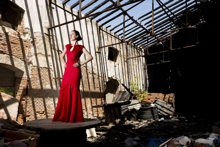 Full Length Of Woman In Dress Standing On Table In Abandoned Building
