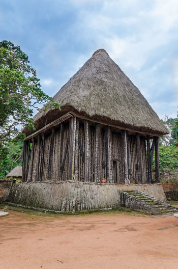 Wood and bamboo temple called Achum at traditional Fon's palace in Bafut, Cameroon, Africa African Architecture Cameroon Tradition Wood Africa Architecture Art Building Building Exterior Built Structure Carved Cloud - Sky Day Nature No People Outdoors Palace Sky Thatched Roof Traditional Tree Wood - Material Wooden