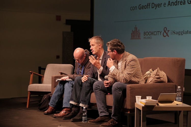 Geoff Dyer with Andrea Gentile at BookcityMilano, Milan, Italy, november 2017 Andrea Gentile Book Festival Event Geoff Dyer Interview Milan Milano Writer Writers Author Book Promo Bookcity Bookcitymilano Conference - Event Famous People Indoors  Italy Men Sitting Talking