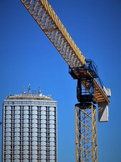 Architecture Blue Building Exterior Built Structure City Clear Sky Construction Equipment Construction Industry Construction Site Crane - Construction Machinery Day Development Industry Low Angle View Machinery Metal Nature No People Outdoors Sky Sunny