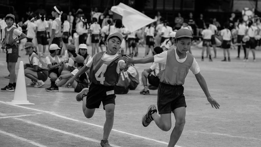 The Sports day of my son's elementary school. Black And White Blackandwhite Elementary School Focus On Foreground Fujifilm Fujifilm X-pro2 Fujifilm_xseries Relay Race Sports Day  The Journalist Eyem 2016 Awards The Portraitist - 2016 EyeEm Awards XF50-140mm