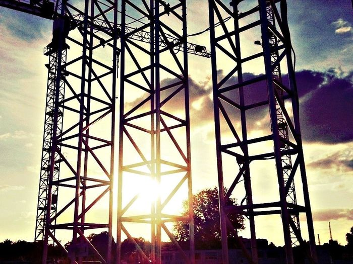Low angle view of built structure against sky at sunset