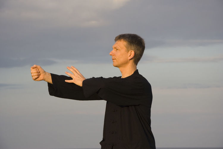Close-up of a man practicing tai chi