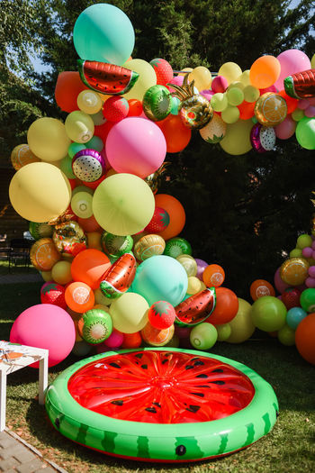 Close-up of multi colored balloons in park
