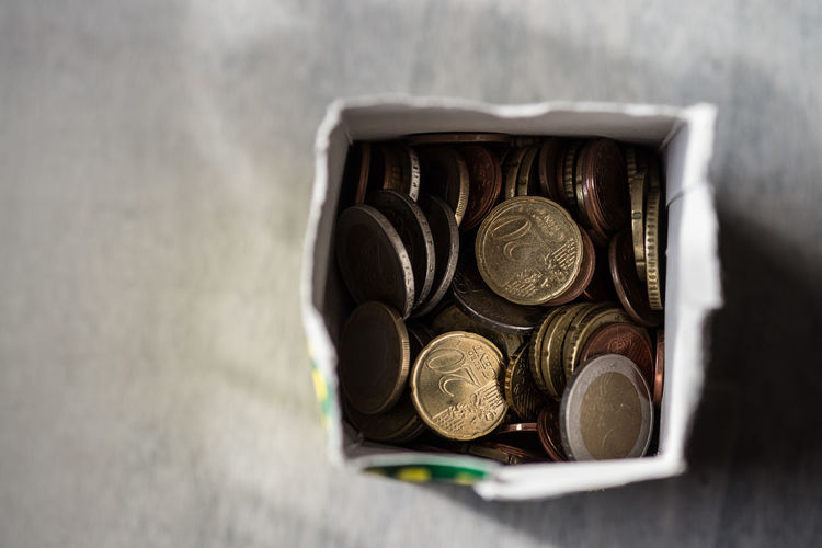 Directly above view of cents in box on table