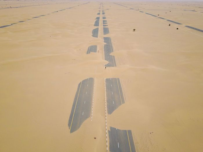 Raw desert Dubai streets Drone  Desert Land Sand Nature Day Water Outdoors High Angle View No People Transportation Built Structure