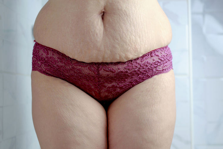 Midsection of woman with pink hair