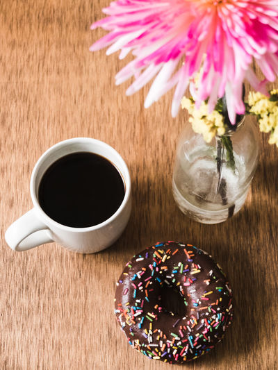 High angle view of doughnut and cup on table