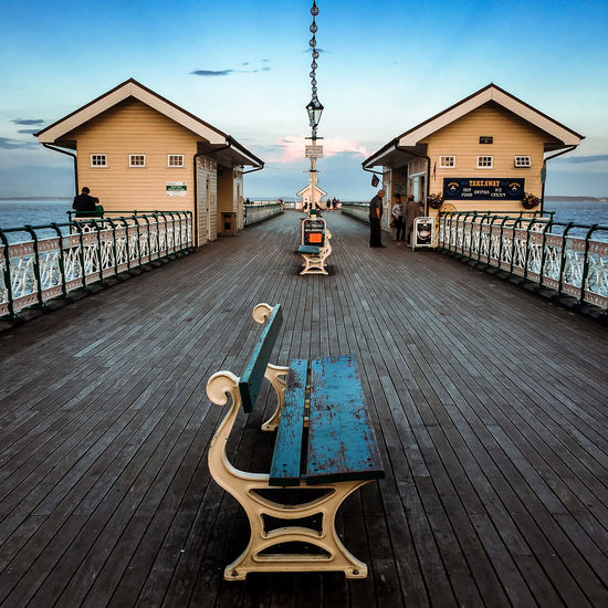 Bench Bench Seat Pier Railing Wood Architecture Blue Blue Sky Boards Built Structure Cloud - Sky Clouds And Sky Day Outdoors Railings And Iron Sea Seaside Seat Sky Sunset Water Wood Paneling