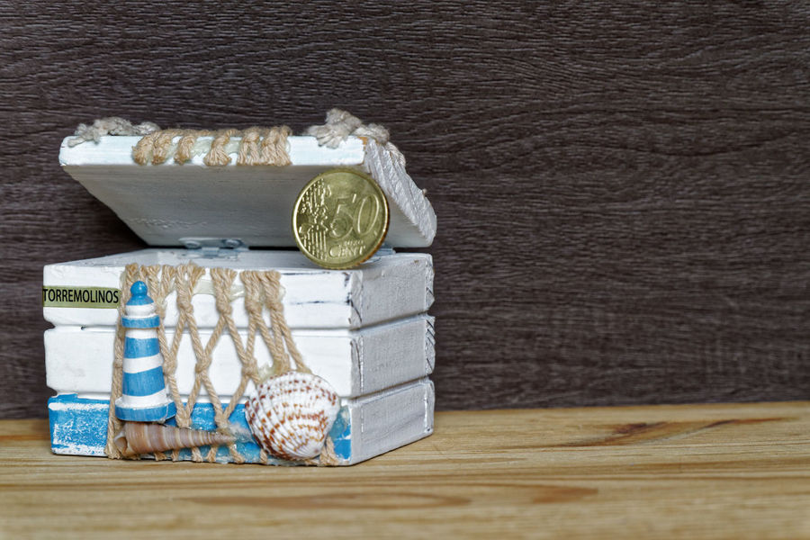 Business decorative objects Business Cents  Money Money Money Salary Banking Business Citrus Fruit Coin Coins Container Currency Dieting Directly Above Euro Cent Euro Cents Euro Coin Euro Coins Euro Currency Euro Money Finance Food Food And Drink Group Of Objects Healthy Eating Indoors  Investment Large Group Of Objects Money Money On My Mind No People Piggy Saving Savings Savings Money SLICE Still Life Table Wage Wealth Wood Wood - Material