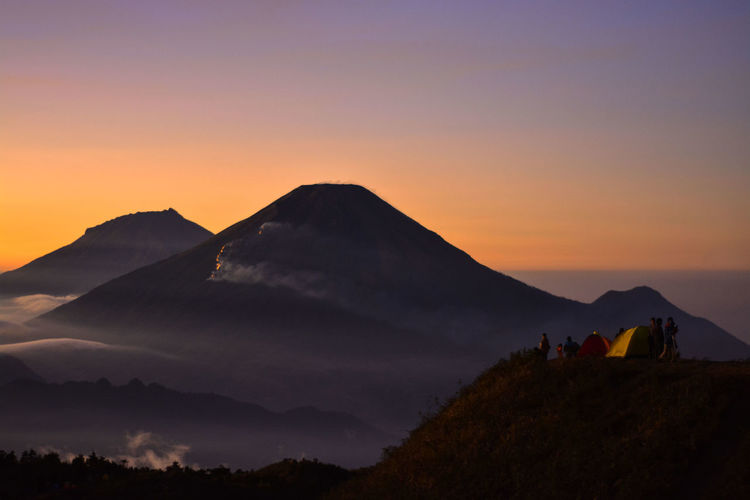 Mount Prau, Central Adventure Beauty In Nature Central Java Environment Group Of People Idyllic Indoors  Landscape Leisure Activity Mountain Mountain Peak Mountain Range Mountains Nature Non-urban Scene Orange Color Outdoors Paradise Scenics - Nature Sky Sunrise Sunset Tranquil Scene Tranquility Travel
