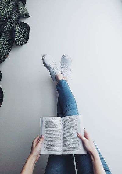 Chill and read Reading Book Legs Real People Indoors  One Person Holding Women Wall - Building Feature Lifestyles Human Body Part Leisure Activity Home Interior Body Part Human Hand Hand Jeans Day