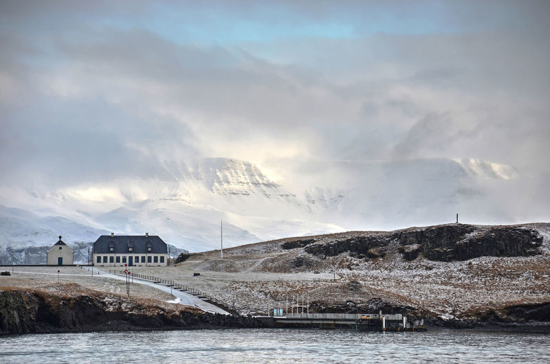 Architecture Beauty In Nature Bridge Bridge - Man Made Structure Building Exterior Built Structure Cloud - Sky Cold Temperature Day Mountain Nature No People Outdoors Scenics - Nature Sea Sky Snowcapped Mountain Water Waterfront Winter