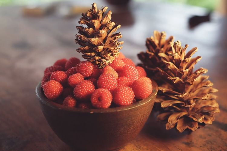 Close-up of berry fruits in bowl on table