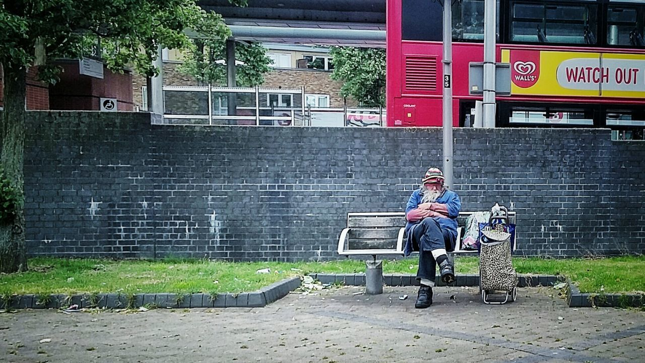 sitting, communication, wireless technology, one person, full length, portability, day, technology, outdoors, people, lifestyles, relaxation, building exterior, adult, architecture, one man only, young adult, adults only