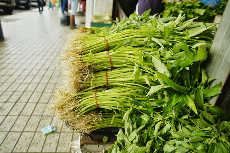 High angle view of vegetables for sale in street