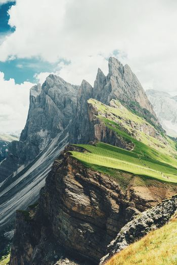 In awe of the Alps. Dolomites Italy Cloud - Sky Sky Beauty In Nature Nature Scenics - Nature Day Tranquility Mountain No People Environment Landscape Tranquil Scene Non-urban Scene Land Sunlight Idyllic Green Color Plant Outdoors Field