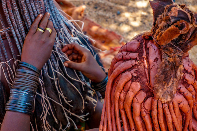 Rear view of himba woman with traditional hair dress