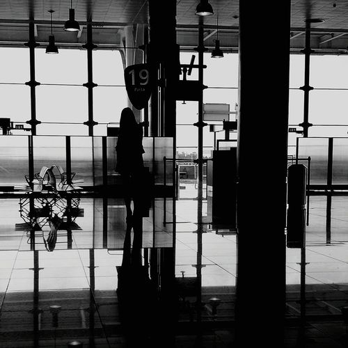The girl on Airport Airportphotography Blackandwhite Expressive Photography Getty Images EyeEm Gallery Travel Photography EyEmNewHere Mode Of Transport Dramatic Scene Travel Destinations Eye4photography  Air Vehicle Airplane Jetlag Girl Friend Oportoairport Oporto Shadows & Lights Shades Silhouette Silence Lady Holidays ☀ Travel Welcome To Black