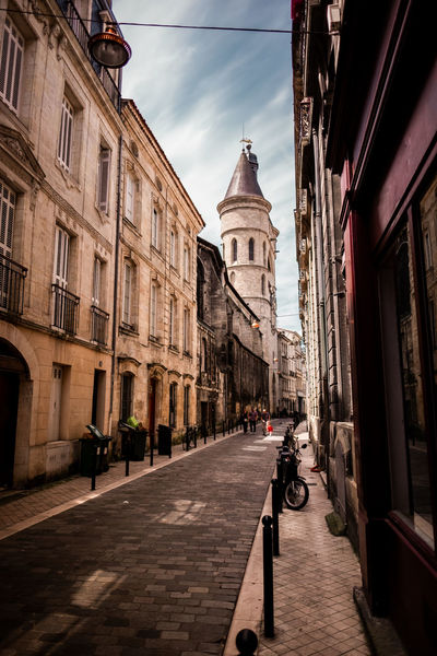 Streets of Bordeaux, France. Architecture Bordeaux Church City Cloudy France Historical Building Old Town Travel Travel Photography Blue Sky Built Structure City Day Fujifilm Fujifilm_xseries Historic History Shadows Sky Street Street Photography Streetphotography Tower Wide Angle