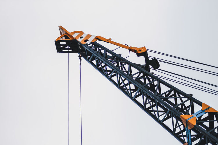 Sky Construction Industry Construction Site Machinery Low Angle View Clear Sky Industry Development Metal Crane - Construction Machinery Nature No People Architecture Construction Machinery Day Built Structure Outdoors Incomplete Construction Equipment Tall - High