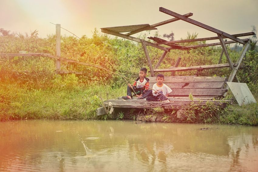 People Outdoors One Person Nature Real People Water Tree Sky Fishing Pond Lifestyles Vintage Retro Boy Village Hobby