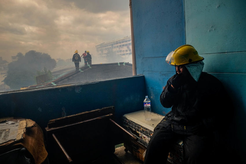Firefighters Firefighters In Action Hardhat  Headwear Outdoors People Real People Sky The Photojournalist - 2017 EyeEm Awards