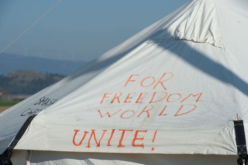 Text on roof of refugee camp