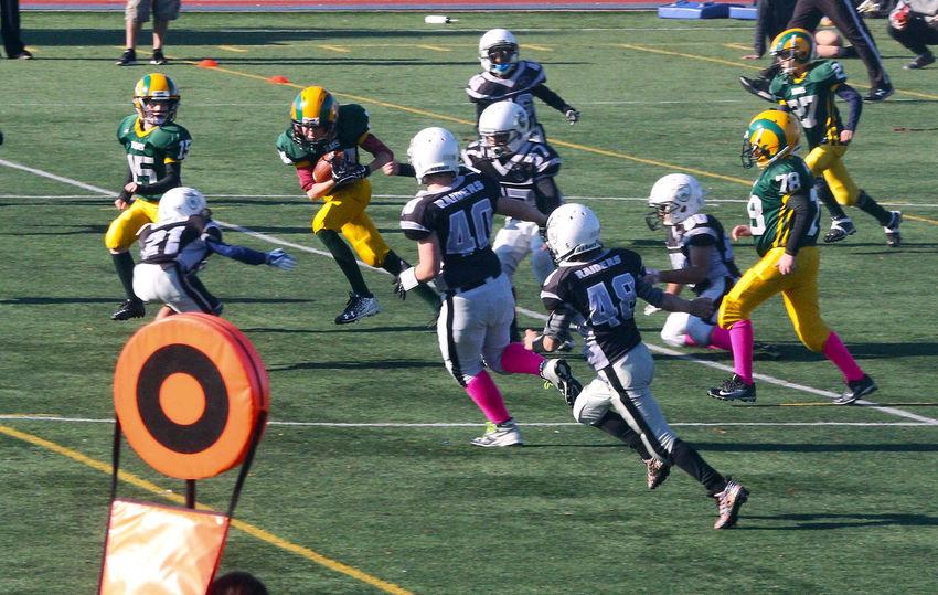Junior football in Minoru Park Richmond B.C. Canada. Competition Sports Clothing Headwear Competitive Sport Sports Helmet Challenge Junior Football Sportsman Athlete Playing Field Richmond Canada B.C junior football Sports Uniform
