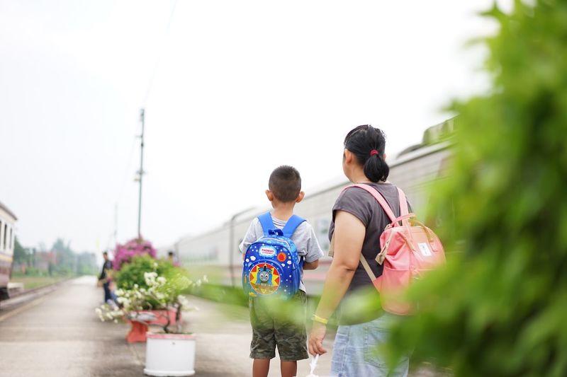 การรอคอย Is waiting for a train. Two People Togetherness Women Men Rear View Lifestyles Real People People Day Females Child Plant Positive Emotion Nature Adult