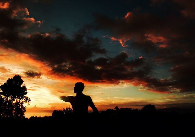 Silhouette Sunset Sky Cloud - Sky Nature Orange Color Beauty In Nature Tranquility Tree Scenics Real People Leisure Activity Lifestyles Tranquil Scene One Person Outdoors Field Men Landscape People First Eyeem Photo EyeEmNewHere