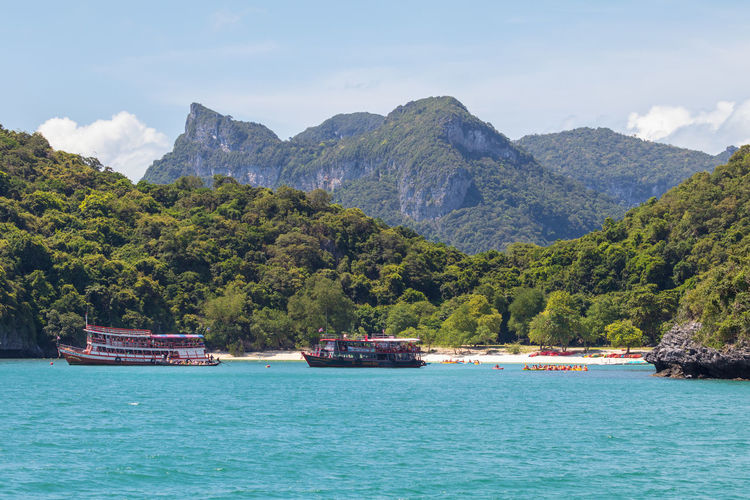 Angthong National Marine Park Thailand Beauty In Nature Day Mountain Mountain Range Nature Nautical Vessel No People Outdoors Passenger Craft Plant Popular Samui_thailand Scenics - Nature Sea Sky Tranquil Scene Tranquility Transportation Travel Tree Turquoise Colored Water Waterfront