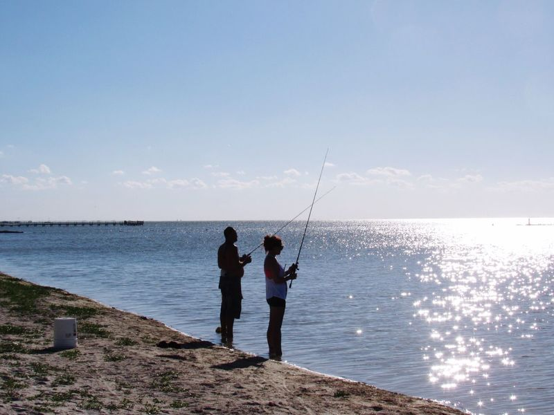 Fishing Beach Life Fishing Poles People Fishing Waterfront Sunshine Beach Photography Rockport Texas Hanging Out Taking Photos Enjoying Life Beauty In Nature Beach Side Water_collection Walking Around Taking Pictures Calm Water