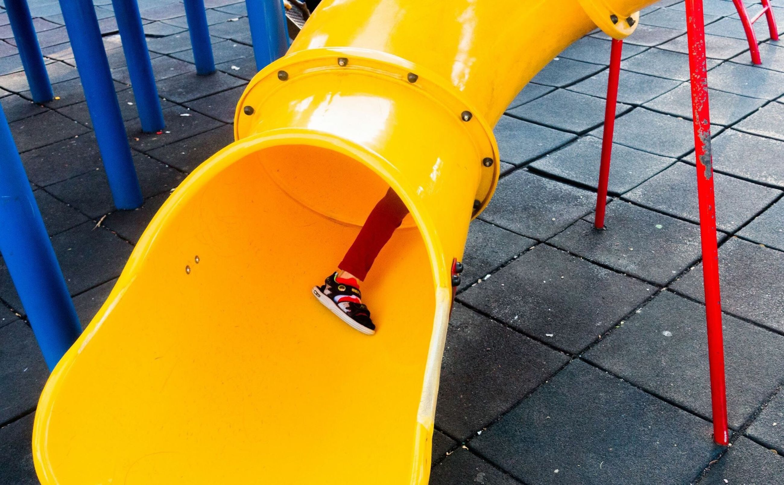 yellow, transportation, mode of transport, orange color, high angle view, metal, close-up, red, railing, day, outdoors, empty, protection, part of, sunlight, absence, travel, playground, no people, safety