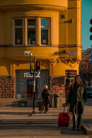 Golden hour in Södermalm, Stockholm Cities Golden Hour Light And Shadow Real People Street Photography Architecture Transportation Street Travel City Men Built Structure Walking People Tourism Travel Destinations Road Streetwise Photography