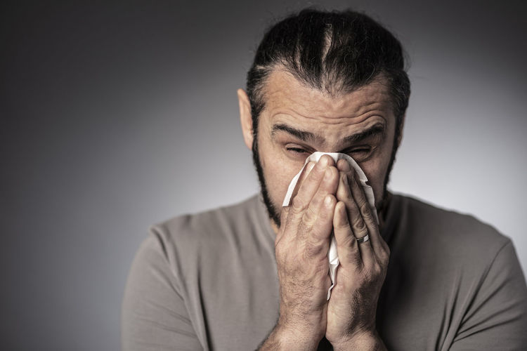 Sick Ill Man Male Cold Flu Virus Disease Infection Young Health Sickness person Fever Adult Influenza Illness Cough Tissue Nose Pain Unwell Sneeze Suffer Medicine White Caucasian Treatment Allergy Ache Unhealthy Symptom Diseased Sneezing