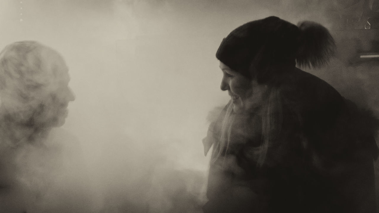 smoke - physical structure, real people, indoors, one person, women, lifestyles, standing, day, people