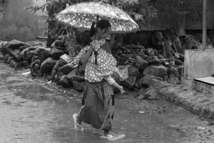 Side view of a woman walking in water