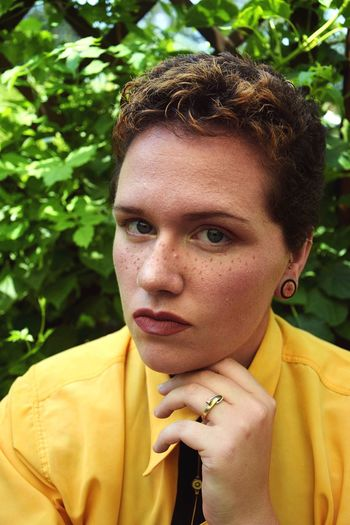 90s vibes. Self Portrait Queer Androgynous Not Your Cliche Portrait Headshot Young Adult One Person Looking At Camera Lifestyles Real People Leisure Activity Front View Day Close-up Plant Focus On Foreground Hairstyle
