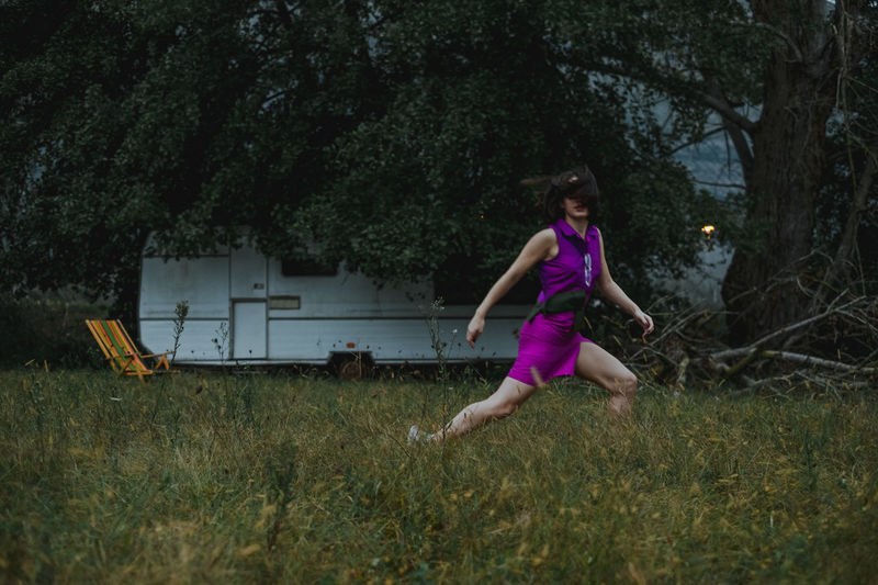 Woman Running Over Field