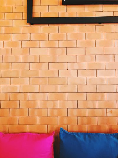 View of cushions by wall at home