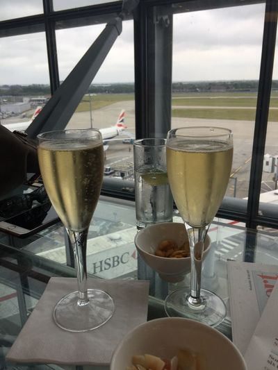 Bon voyage! Champagne Luxury Anticipation Excitement Business Lounge Airport Drink Food And Drink Alcohol Refreshment Table Drinking Glass Close-up