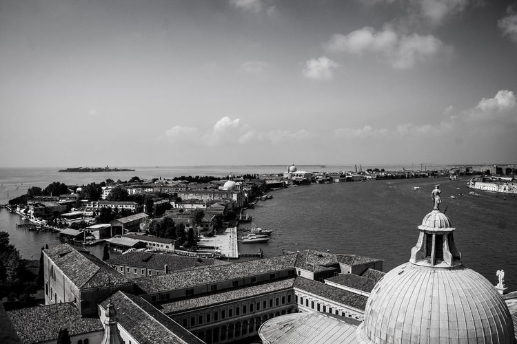 High angle view of san giorgio maggiore and grand canal against sky on sunny day in city