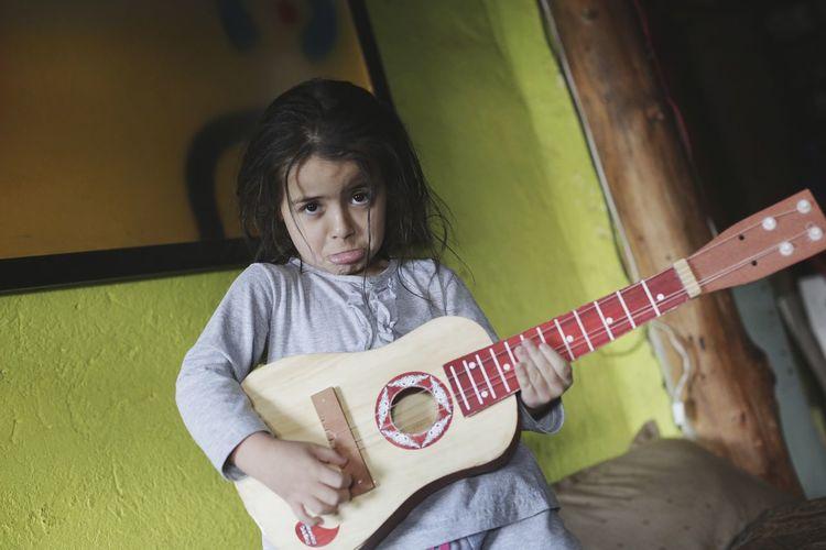 guitar babygirl Plucking An Instrument Guitar Child Musical Instrument Childhood Portrait Playing Girls Music Electric Guitar String Instrument Classical Guitar Musical Instrument String Guitarist Rock Musician
