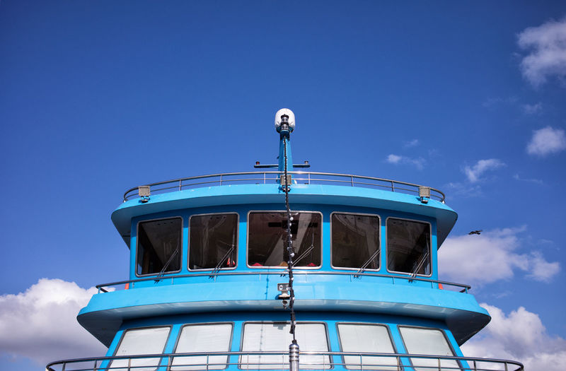 Low angle view of boat against blue sky