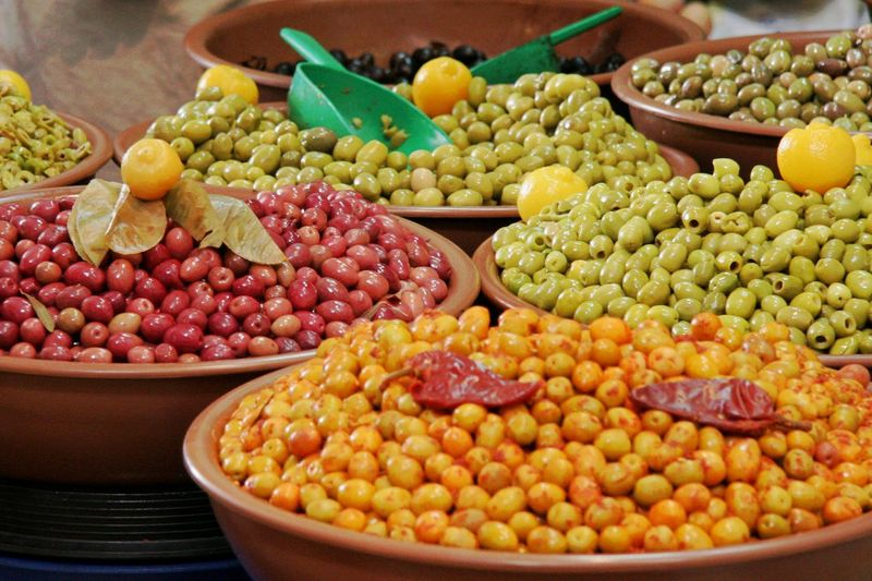 High angle view of colorful olives in container for sale